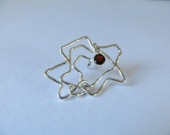 Rosebrooch......My rose is a rose is a rose....Petit silver flower pinbrooch with a little robin gemstones;