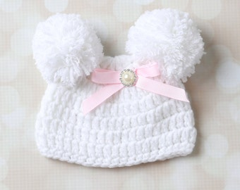 White Newborn Pom Pom Hat with pink ribbon bow with a pearl and rhinestone center, photograph, baby hat, small hat from Lil Miss Sweet Pea