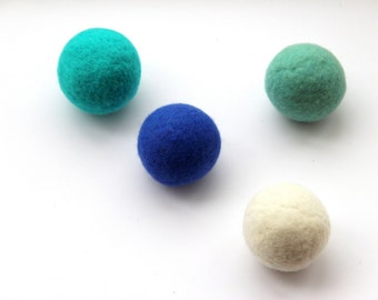 Wool dryer balls set of 4, sea glass. Handmade of 100% wool. Replaces fabric softener and dryer sheets for natural laundry care. Made in CT.