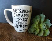 """Hand painted ceramic mug with funny quote """"Day Drinking From a Mug to Keep Things Professional"""", 12 oz. white"""