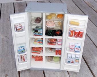 Dollhouse fridge/freezer filled with food