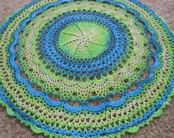 Handcrochet lace doily, in shades of green, self striping thread