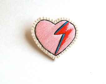Heart brooch embroidered with pink, red and blue lightning bolt on cream muslin with cream felt back David Bowie tribute Made to order