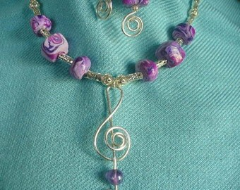 Treble Clef Coiled Wire Pendant Necklace - silver with purple beads