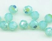 24 gorgeous Swarovski crystals - art 5000 - 6 mm - pacific opal AB
