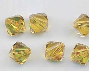 Eight super-rare vintage Swarovski crystal beads: Art. 364/5301 - 12 mm - light topaz AB