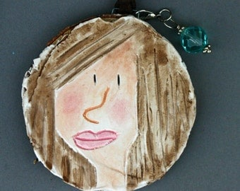 Face, portrait, wall art on wood slice, Christmas ornament, girl face, round face, plaster of paris, carved, small art, brown hair