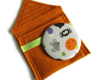 Cosmetic pocket mirror pouch in burnt orange felt with mirror- fabric covered handbag mirror