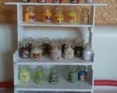 Miniature Shelf full of Candles