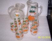 Vintage Orange Juice Pitchers and 7 glasses