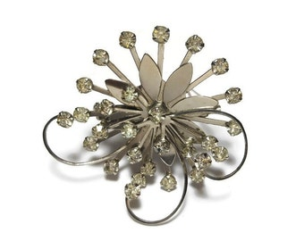 Rhinestone daisy brooch, clear rhinestones, silver tone flower, swirl pinwheel design, 1930s estimated age, faceted prong set