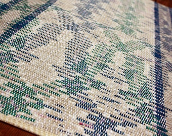 Handwoven neutral with blues and greens rug