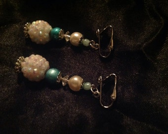 Glittery iridescent with turquoise clip on earrings