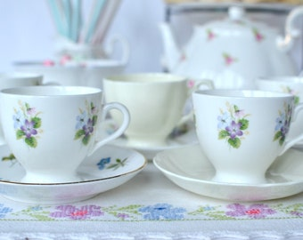 Set of 5 coffee cups / small tea cups and mismatched saucers, delicate violets mixed with dainty Spring flowers