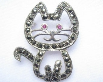 "SALE Sterling & Marcasite Cat Brooch with Faceted Light Ruby Colored Eyes.  Signed 925.  Nearly 1-3/8""."