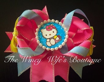 Hello kitty themed boutique bow, hello kitty, bow, stacked bow, bow, gift
