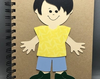 A5 Boy Dress-Up Doll Diary notebook complete with twenty two accessories