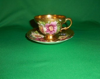 "One (1), 2 1/2"" Footed, Bone China, Tea Cup & Saucer, from Rosina, in the 5164 Pattern."