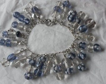 Loaded lilac and clear glass beaded charm bracelet