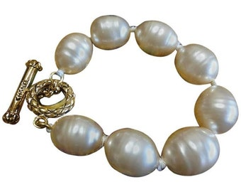Vintage CHANEL extra large faux baroque pearl bracelet with logo embossed hardware. Rare vintage jewelry from Chanel.
