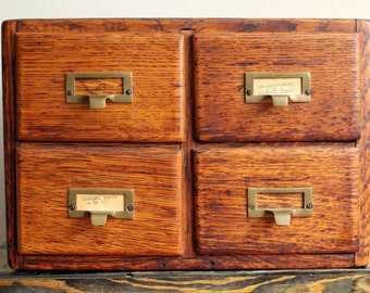 Vintage Library Card Catalog - 4 Drawer Wooden Oak Apothecary Cabinet w. Brass Hardware in Good Condition