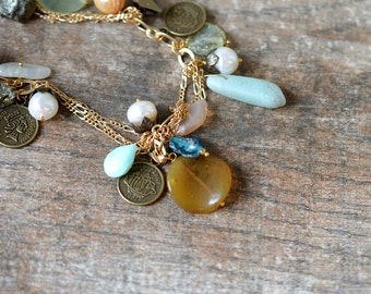 Exotic amulet necklace Bohemian dangle necklace Aqua ancient Roman glass bead Bronze replica coin necklace Gold chain necklace