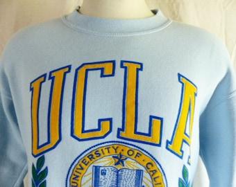 Go  UCLA Bruins vintage 80's University of California Los Angeles light blue fleece graphic sweatshirt crest mascot puffy print back front L