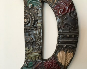 "Patchwork letter ""D"" designed with antique tin ceiling tile"
