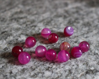 Smooth 10mm tinted pink agate beads