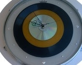 "12"" Drum skin Clock  - 'Remo' Drum skin & ring w/ Rare yellow 45 and 78 record and a CD."