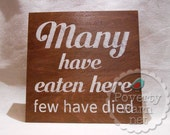 Many Have Eaten Here Few Have Died Stained and Painted Wood Sign