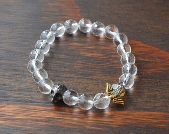 Crystal Quartz Bracelet. Skull Bracelet. Angel Wing Bracelet. Dia de los Muertos Bracelet. Women's Beaded Bracelet. Lotus and Lava Bracelet.