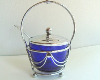 Cobalt blue jam jar with in silver stand