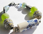 Stretchy Bracelet: Flower Patterned Ceramic Bead, Kashmiri Beads, Fire Agate, Jasper, and Recycled Glass Beads