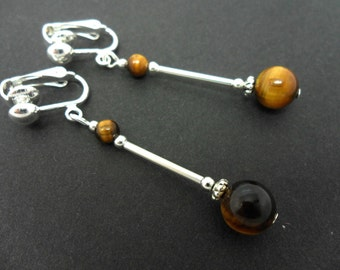 A pair of pretty tigers eye  bead  dangly clip on  earrings.