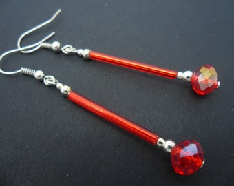 A pair of pretty silver plated red  glass crystal  bead dangly earrings.