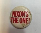 Nixon's the One campaign button.