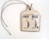 random number tile (35.)