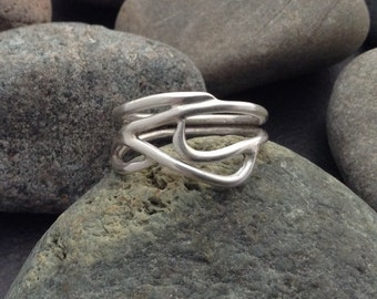 Sterling silver ring, flowing soldered interwoven tree  branches, vines,  wrap around finger, size 7