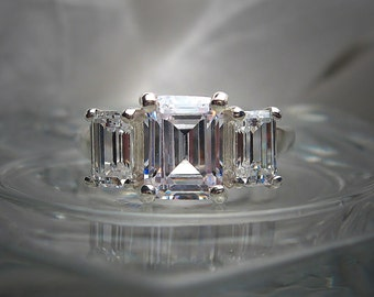Warmer White 8x6mm/6x4mm Three Stone Emerald Cut Cubic Zirconia .925 Sterling Silver Engagement Ring Made to Order
