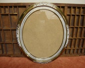 Gold and White Oval Frame
