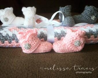 Girl's crochet baby blanket and booties