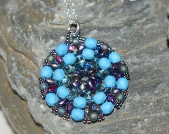 Circular bead woven pendant with sterling trace chain