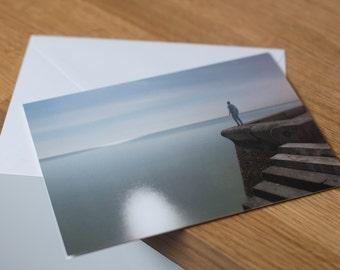 Falling into a deep, deep sleep - a moonlit, long exposure seascape. Fine art photography greetings card. Blank inside.