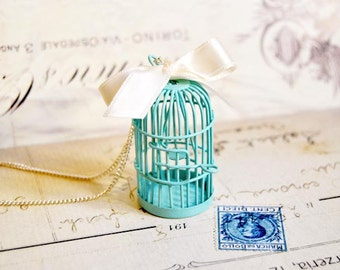Vintage blue birdcage long necklace decorated with a white satin bow