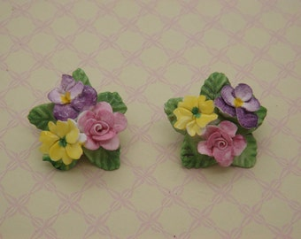 A fine Coalbrook china pair of floral clip on vintage jewelry earrings of flowers hand made and painted using English bone china / porcelain