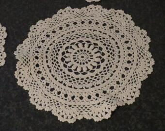 Vintage set of 4 broken white crocheted doilies 1970s. Diameter about 17 cm.