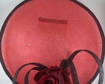 Red Sinamay saucer hat with red and black details.