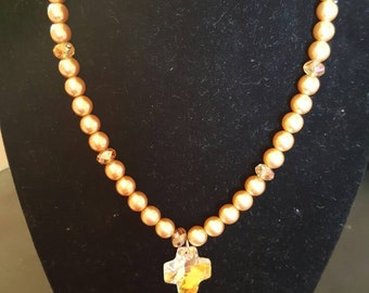 Yellow pearl beaded necklace with cross pendent.