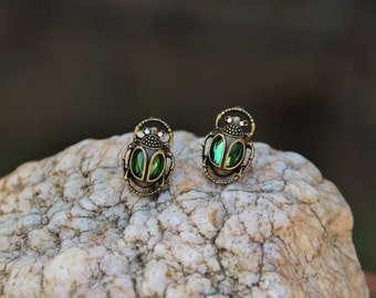 Green stone and gold bug earrings